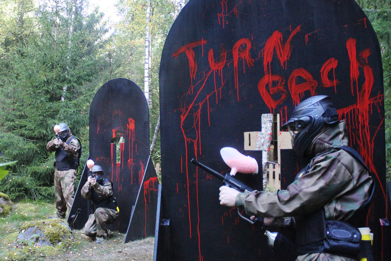 Nottingham Paintball - Players Exchange Fire Behind Bloody Gravestones