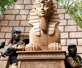 Two players take cover on either side of sphinx statue