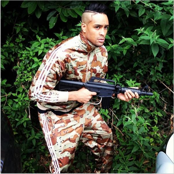 Ashley Banjo Poses In Camo Holding M16 Paintball Gun