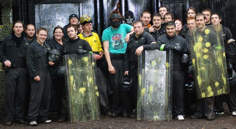 Players pose with paintball shields