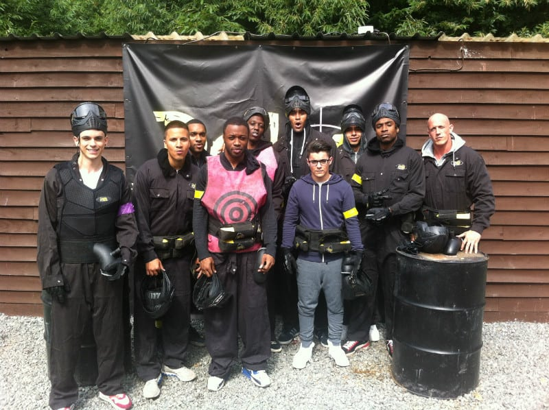 Dance Group Diversity Pose At Delta Force Paintball