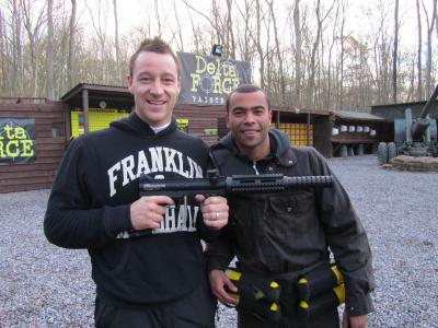 John Terry and Ashley Cole pose with paintball gun