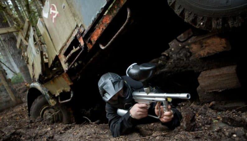 Player takes shot under Soviet truck