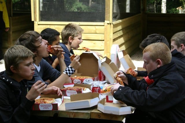 Kids Eating Pizza Lunch at Paintball Centre