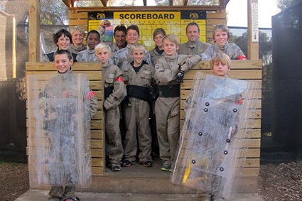 Scouts pose with paintball riot shields