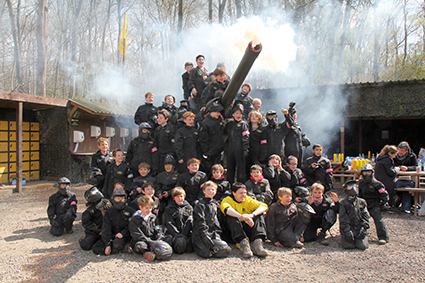 Kids pose with Howitzer gun at Effingham basecamp