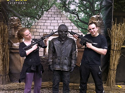 Two players hold paintball guns to Terminator's head