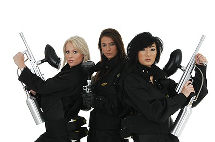 Three female models pose with Delta Force equipment