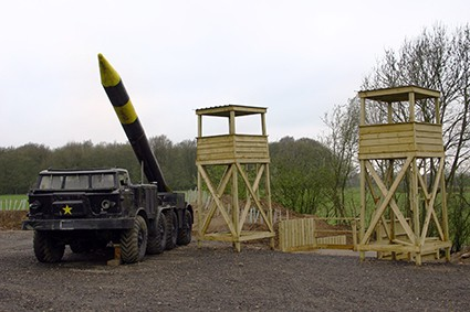 Scud missile beside two towers