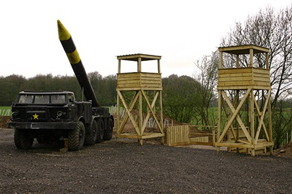 Rocket-mounted truck next to two tower outposts