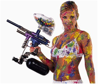 Woman in underwear covered in paint holding paintball gun