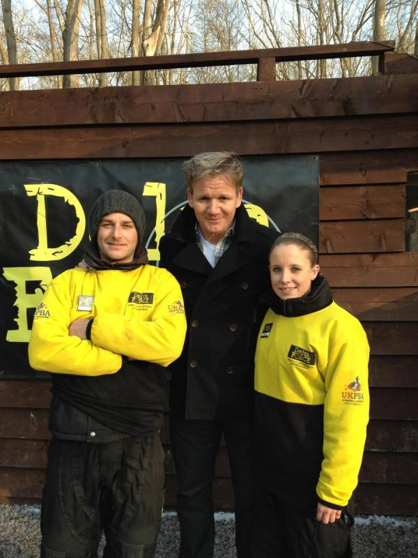 Gordon Ramsay poses with two marshals