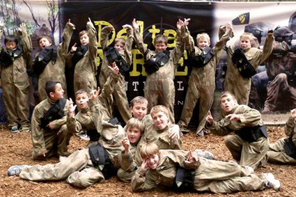 Scouts celebrate at Delta Force Paintball base camp