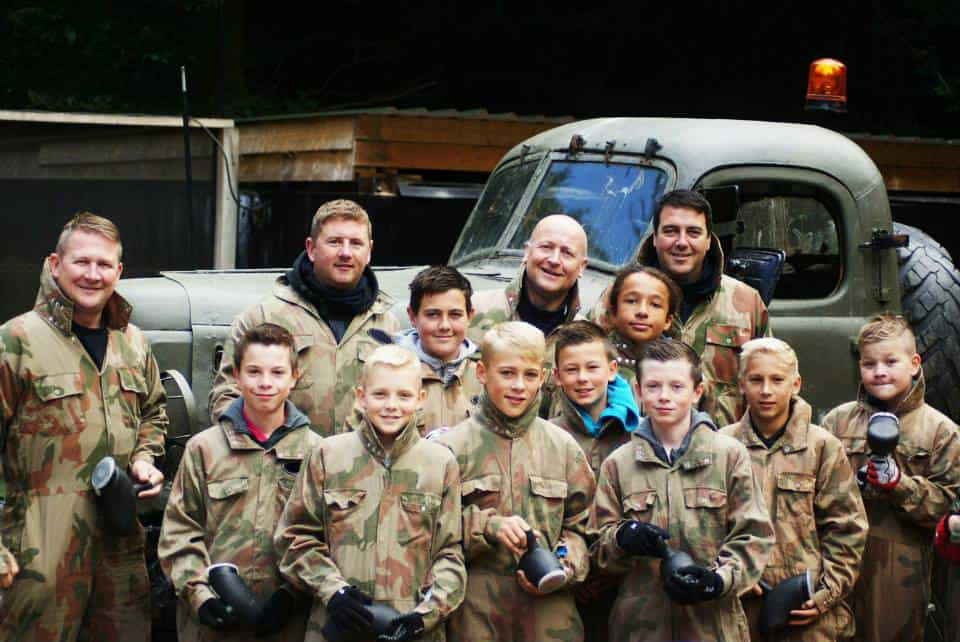 School group smiling at Delta Force Paintball base camp