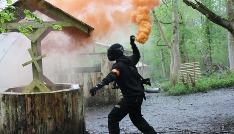 Paintball Player Throwing Smoke Grenade