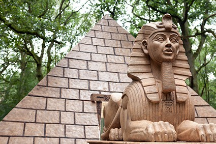 Sphinx statue in front of pyramid