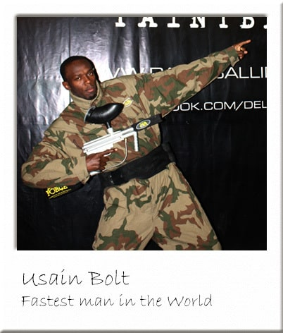 Usain Bolt Posing with a Paintball Gun
