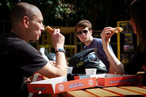 Man watches couple eat pizza