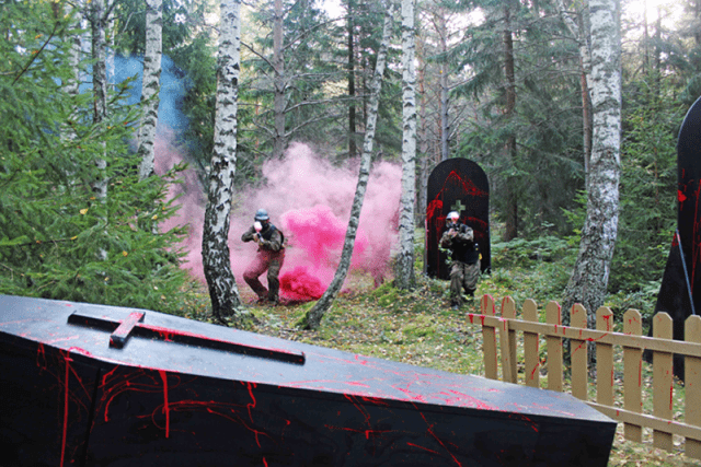 Two players move from smoke to blood-spattered coffin