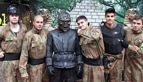 Adult Paintball Players Posing with Terminator