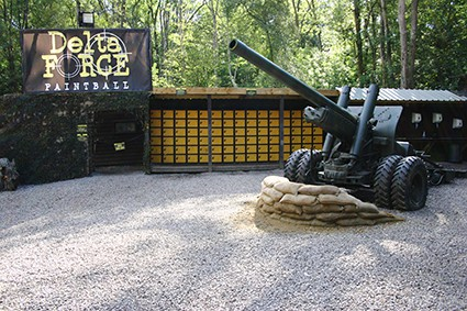 Howitzer gun behind sandbags in base camp