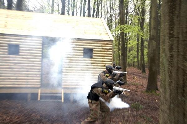 Two players advance round smoking hut