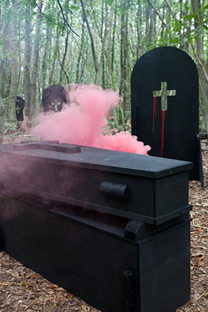 Coffins consumed by smoke