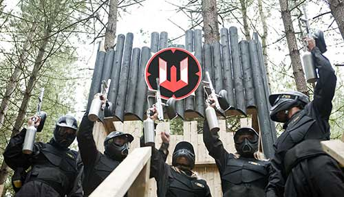 Players Raise Paintball Guns at Castle Wallenberg